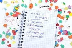 Resoluciones y confeti del Año Nuevo Foto de archivo