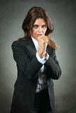 Resolute business woman ready for the fight Royalty Free Stock Photos