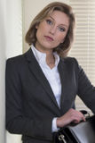 Resolute/Motivated businesswoman stock photography