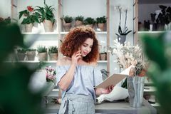 Resolute positive young lady spending day in flower shop