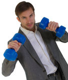 Businessman with dumbbells in hands Royalty Free Stock Photos