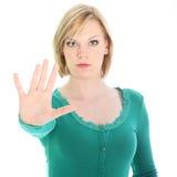 Resolute vrouw die een halt met haar hand roept stock foto's