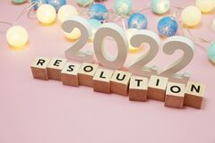 Resolution 2022 word alphabet letters on pink background
