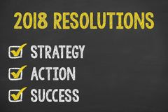 Resolutions 2018 on Chalkboard. New year working Stock Image
