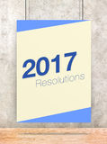 2017 Resolutions on cream and blue pastel color poster hanging o. N concrete wall and wood floor,Holiday greeting card Royalty Free Stock Photography