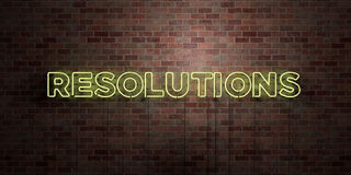 RESOLUTIONS - fluorescent Neon tube Sign on brickwork - Front view - 3D rendered royalty free stock picture. Can be used for online banner ads and direct Royalty Free Stock Photography