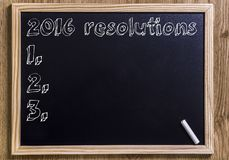 2016 resolutions. New chalkboard with 3D outlined text - on wood Royalty Free Stock Photos