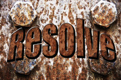 Resolve Text on Rusted Iron Plate Stock Photos