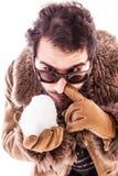 Resoplando una bola de nieve Foto de archivo