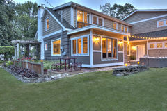 Resored Cape Cod Home at dusk Royalty Free Stock Images