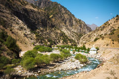 Resort along Mountain moraine river. Under cloudy sky in summertime in Takob, Tajikistan Royalty Free Stock Photography