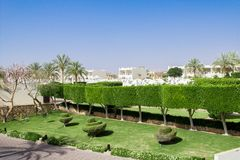 Resort architecture in Egypt, beautiful garden at hotel resort and building in traditional arabic style. Beautiful garden at hotel resort and building in Royalty Free Stock Photos