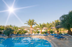 Resort, azure swimming pool. Royalty Free Stock Photography