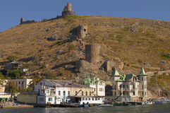 Resort in Balaklava bay. The ruins of the Genoese fortress. Crimea stock photography