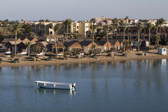 Resort Beach and the boat on the water. Stock Photography
