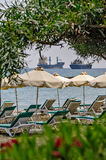 Resort beach and freight ships Stock Photography