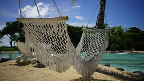 Resort Beach Hammock. A close up view of a beach hammock in a summer tropical resort Stock Images