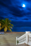 Resort Beach Night. A set of stairs leads out to a white sandy beach in Ocho Rios Jamaica Stock Photos