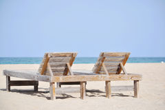 Resort beach chairs on the sand by the sea Royalty Free Stock Photos