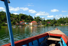 Resort from bow of boat plancha. Resort motels on Island stop from the bow of a boat or plancha heading toward it Royalty Free Stock Photo