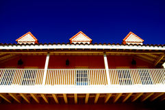 Resort building. Closeup of a resort building with railing and blue skies Royalty Free Stock Image