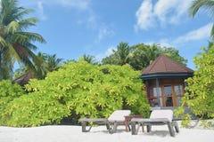 Resort chalets next to white sandy beach Stock Photo