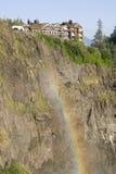 Resort on cliff rainbow Stock Images