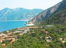 Resort coastline among high mountains and sea view Royalty Free Stock Photography