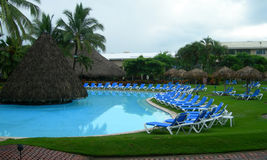 Resort in Costa Rica with poolside lounge chairs Stock Photos