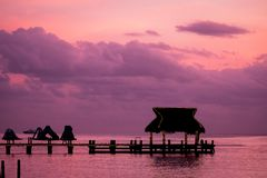 Resort dock tropical destination silhouette in the sunset light Royalty Free Stock Images