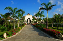 Resort entrance. Tropical resorts entrance with a garden full of colors Stock Photo