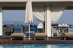 Resort facilities for summer holyday. Pool restaurant near the beach Royalty Free Stock Images