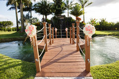 Resort footbridge and pond Royalty Free Stock Photo