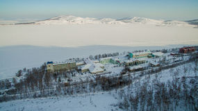 Resort on frozen lake in the mountains. Aerial. Ural, Russia Stock Photo