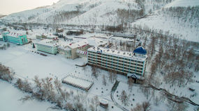 Resort on frozen lake in the mountains. Aerial. Ural, Russia Royalty Free Stock Images