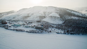 Resort on frozen lake in the mountains. Aerial. Ural, Russia Royalty Free Stock Photo