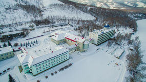 Resort on frozen lake in the mountains. Aerial. Ural, Russia Royalty Free Stock Photos