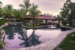 Resort garden pool at twilight Royalty Free Stock Photography