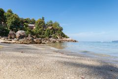 Resort on hill with white sand beach royalty free stock image