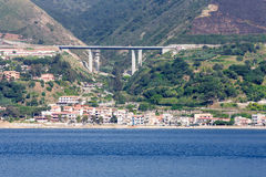 Resort Homes Under Highway Bridge on Italian Coast Royalty Free Stock Image