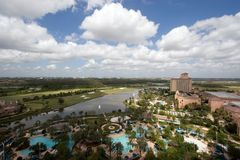 Resort Hotel. Wide angle view of a resort hotel from above, with a blue sky, buildings, a pool, lake and golf course Stock Photo