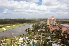 Resort Hotel. View of a resort hotel from above, with a blue sky, buildings, a pool, lake and golf course Royalty Free Stock Photo