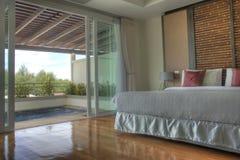 Resort hotel bedroom Stock Photos