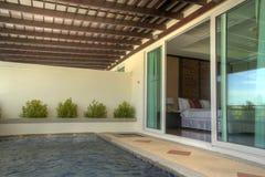 Resort hotel bedroom Stock Photography