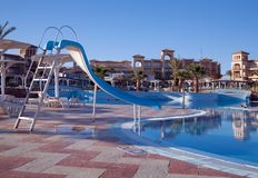 Resort hotel with a pool. Tropical resort hotels with beautiful pool in foreground Royalty Free Stock Photos
