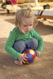 Resort hotel provides entertainment for children. Kid child play with ball alone. Boy cute want to have fun. Baby boy. Blonde hair play with ball outdoors stock photography