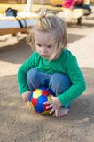Resort hotel provides entertainment for children. Kid child play with ball alone. Boy cute want to have fun. Baby boy. Blonde hair play with ball outdoors royalty free stock photos