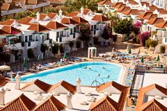 Resort houses. Aerial view of houses and swimming pool at a sunny tropical resort Stock Photo