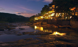 Resort on island of Sri Lanka at night. With lights reflecting on water stock image