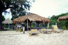 Resort on Koh Phayam island with bungalows and deck-chair Stock Photos